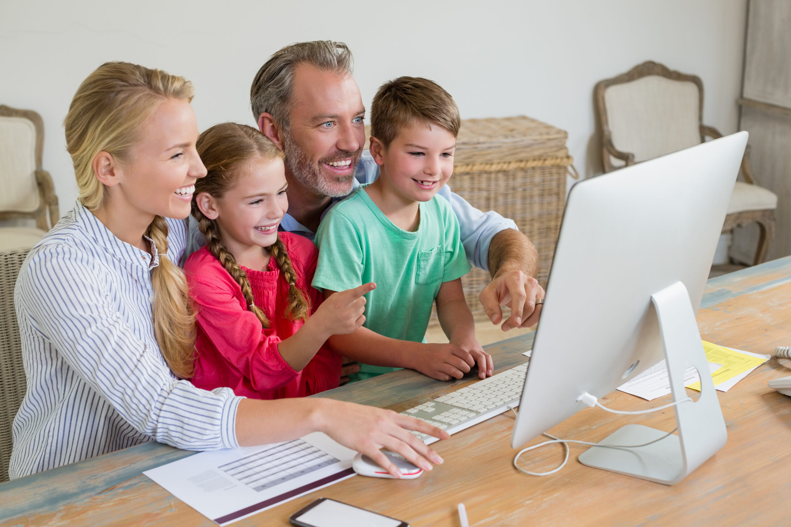 family using computer at home 9PDDMNW scaled RESIDENTIAL